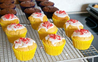 Vanilla muffins made with custard powder, filled with your favourite jam and drizzled with glacé icing