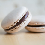 Chocolate macarons filled with dark chocolate ganache