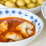Mojo rojo sauce with white fish fillets and salted new potatoes