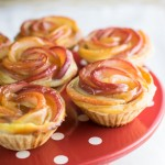 Cinnamon pastry cases filled with vanilla cheesecake and topped with a poached apple rose. Beautiful, elegant and really not too hard to do!