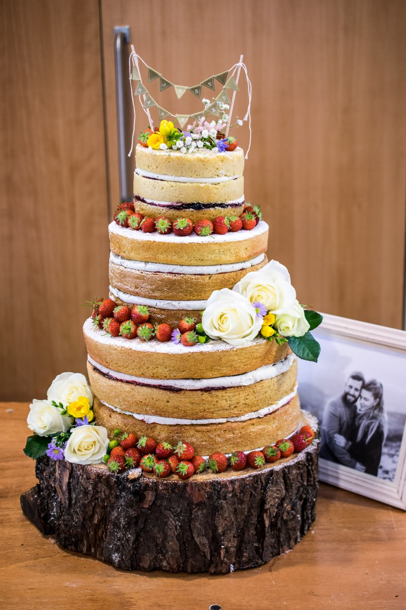 Naked wedding cake made with a dairy free vanilla (soy) yogurt cake recipe, filled with dairy free buttercream, homemade jam and decorated with summer fruit