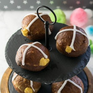 Hot cross donuts - sweet and spicy enriched dough, deep fried before being giving an orange glaze, filled with a citrus scented custard and topped with an icing cross