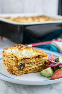 Greek lamb lasagne is a new take on a traditional Italian, beef ragu lasagne. With olives, feta and lamb this is one satisfying lasagne.