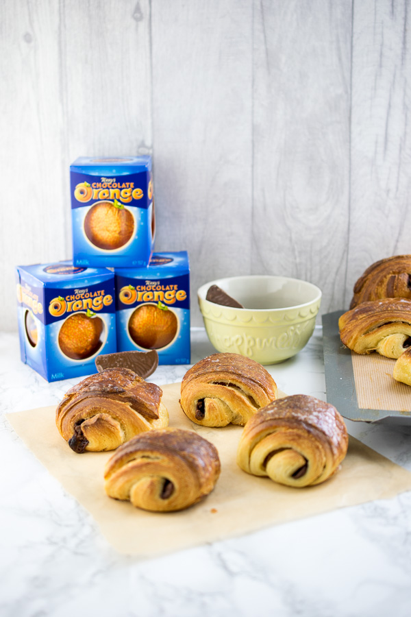 Orange scented homemade Danish pastry, filled with segments of Terry's Chocolate Orange and brushed with orange syrup. Super soft, super flakey and extremely buttery these are pain au chocolat perfection!