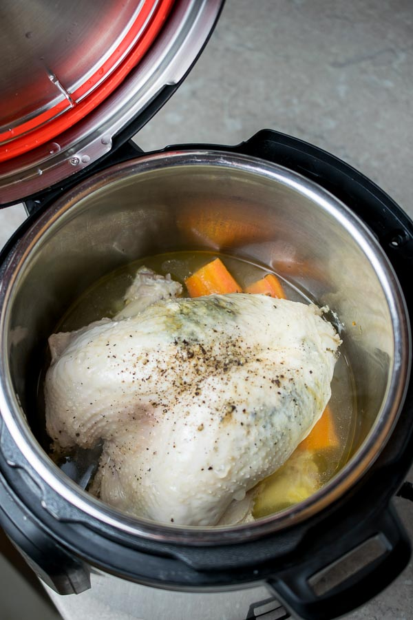 A seasoned turkey crown on a veg trivet ready to cook in the Instant Pot
