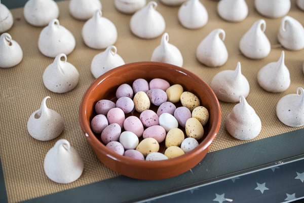 Meringue kisses and a bowl of Mini Eggs, before they get crushed to a nubbly rubble.
