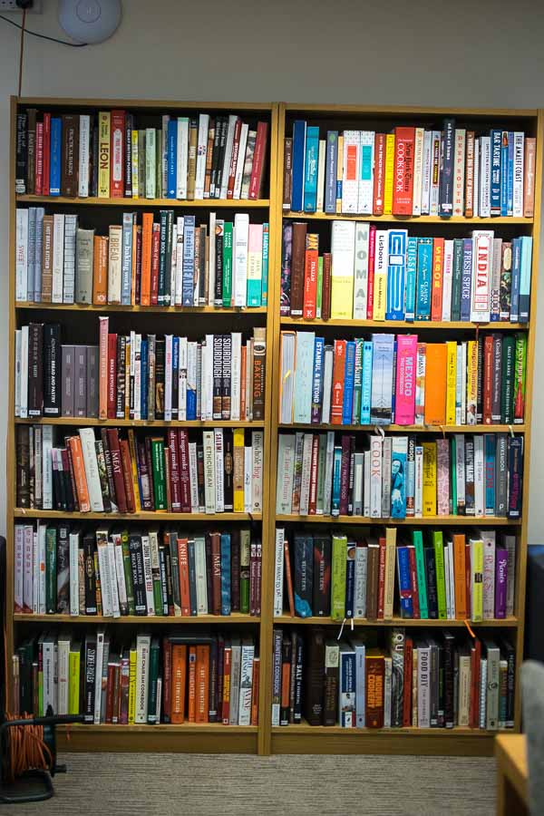 Well stocked bookshelf at the School of Artisan Food's library
